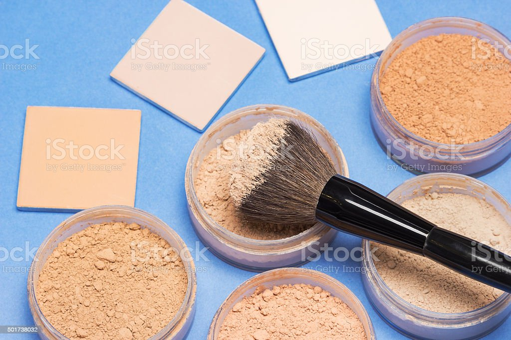 Different shades of loose and compact cosmetic powder stock photo