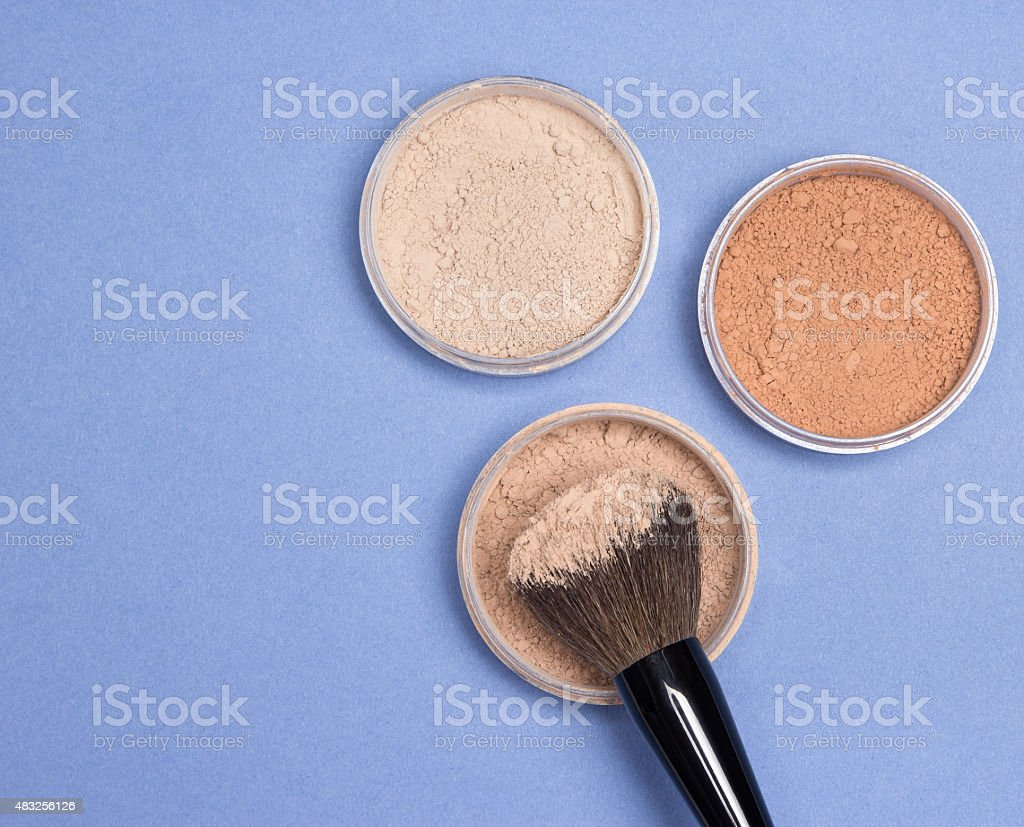 Different shades of loose cosmetic powder stock photo
