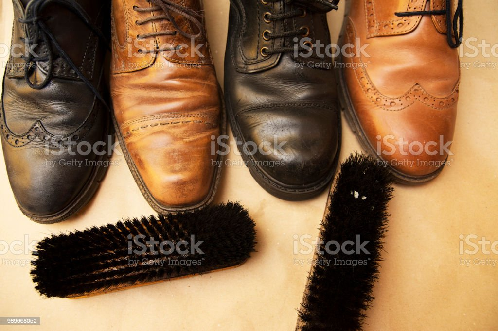 Different shoes and two polishers stock photo