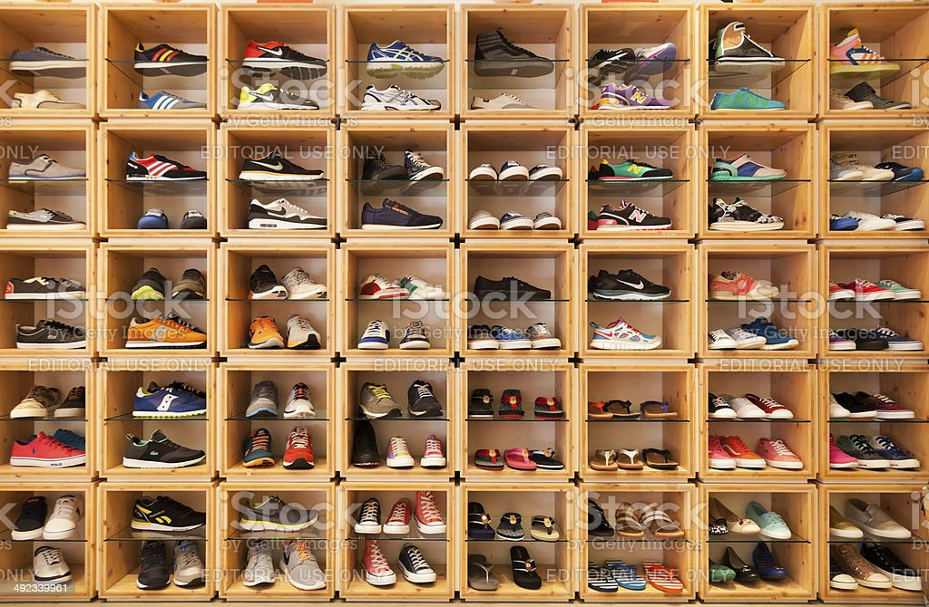 Different shoes displayed in a shoe shop.