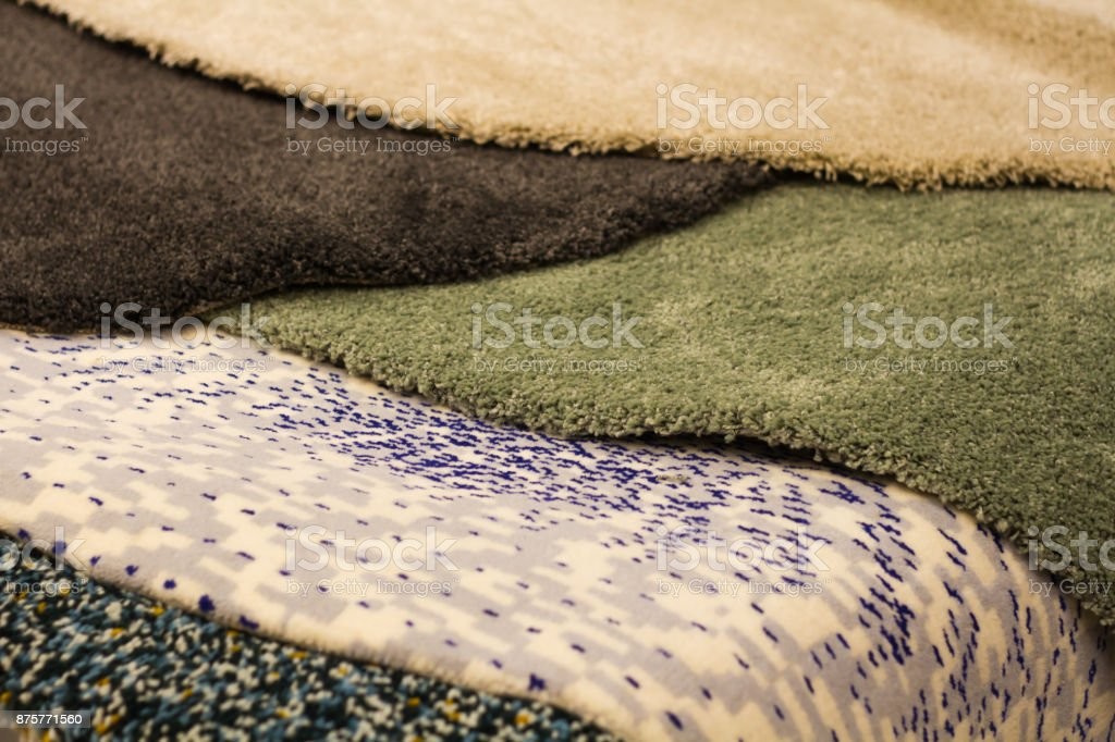 Different short wool rugs are colored in the overlap horizontally to the counter stock photo