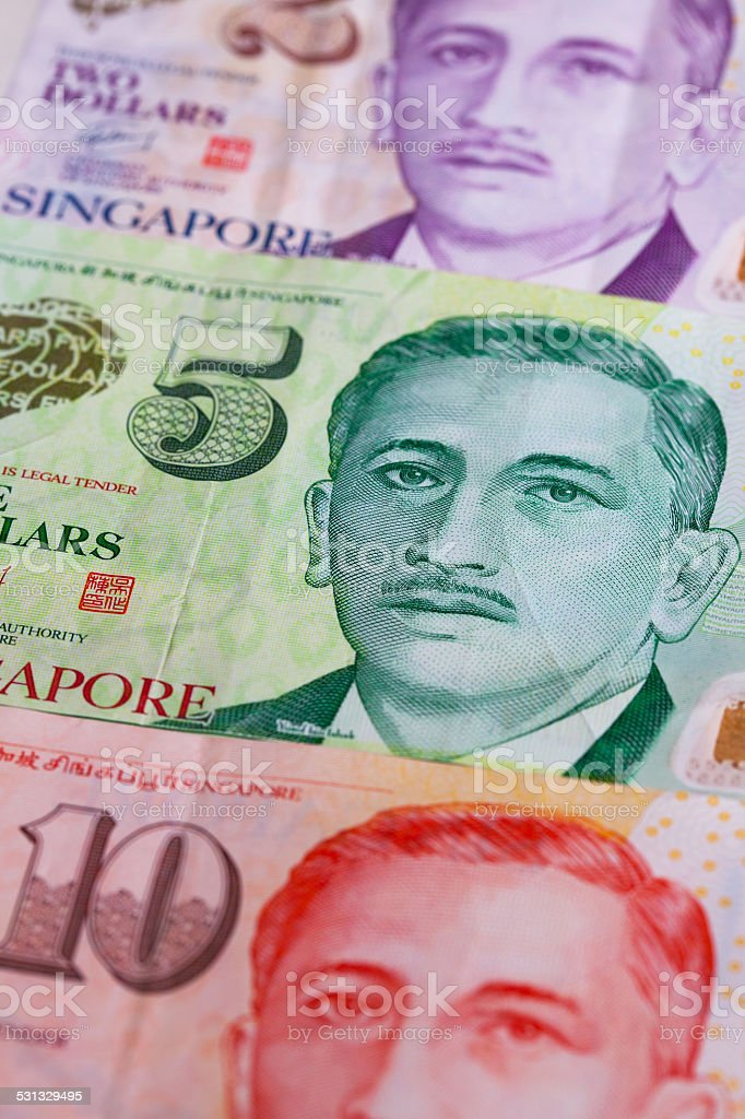 Different Singapore Dollar banknotes on the table stock photo