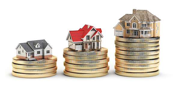 Different size houses vith different value on stacks of coins. Concept for property, mortgage and real estate investment.  3d illustration