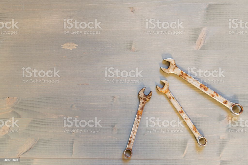 Different size wrenches on wooden background stock photo