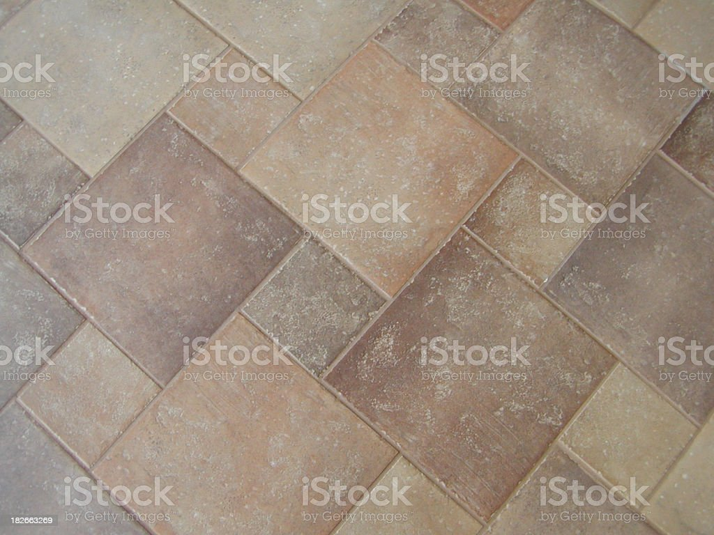 Different sized and asymmetrically arranged tiles on floor royalty-free stock photo