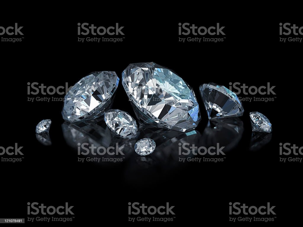 Different sized, cut and polished diamonds isolated on black royalty-free stock photo