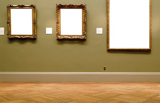 Three empty frames at a museum.