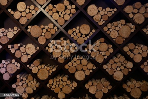 different sizes of logs lie on a square shelves for the decoration of the restaurant
