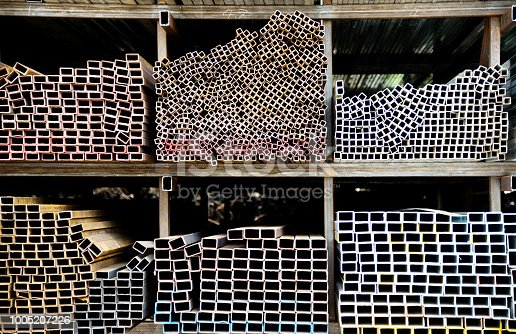 istock Different sizes of square steel tubes on the shelf 1005207226