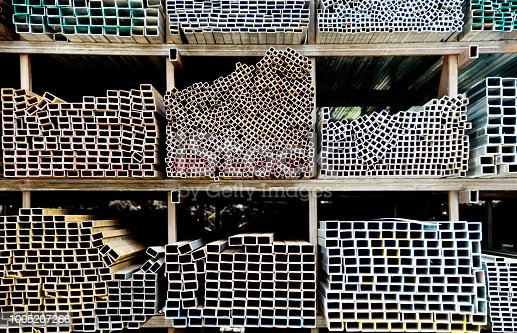 istock Different sizes of square steel tubes on the shelf 1005207266