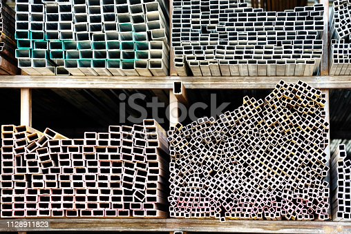 istock Different sizes of square steel tubes on the shelf 1128911823
