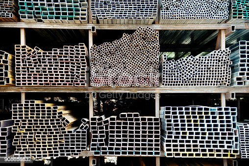 istock Different sizes of square steel tubes on the shelf 908686832