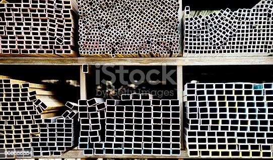 istock Different sizes of square steel tubes on the shelf 908686884