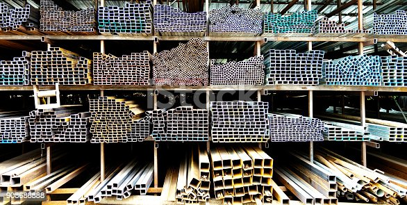 istock Different sizes of square steel tubes on the shelf 908686888