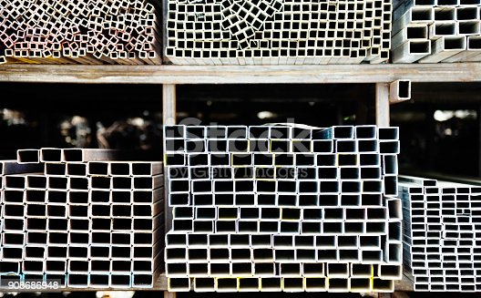 istock Different sizes of square steel tubes on the shelf 908686948