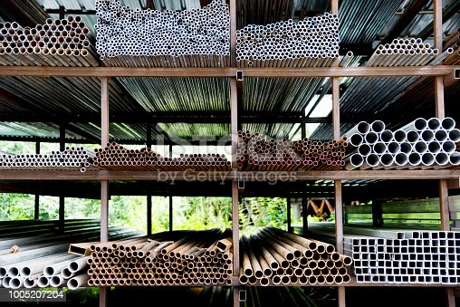 istock Different sizes of steel tubes on the shelf 1005207204