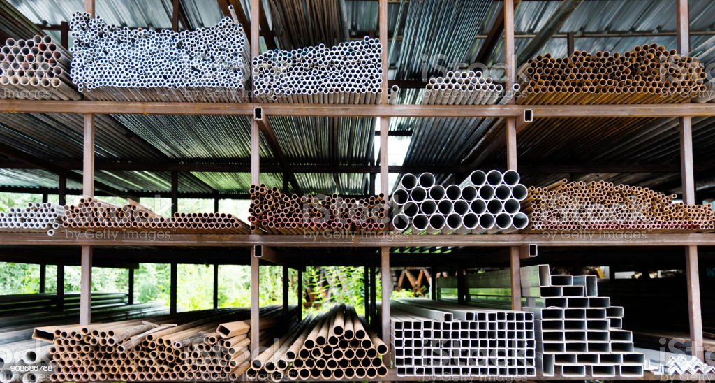 Different sizes of steel tubes on the shelf stock photo