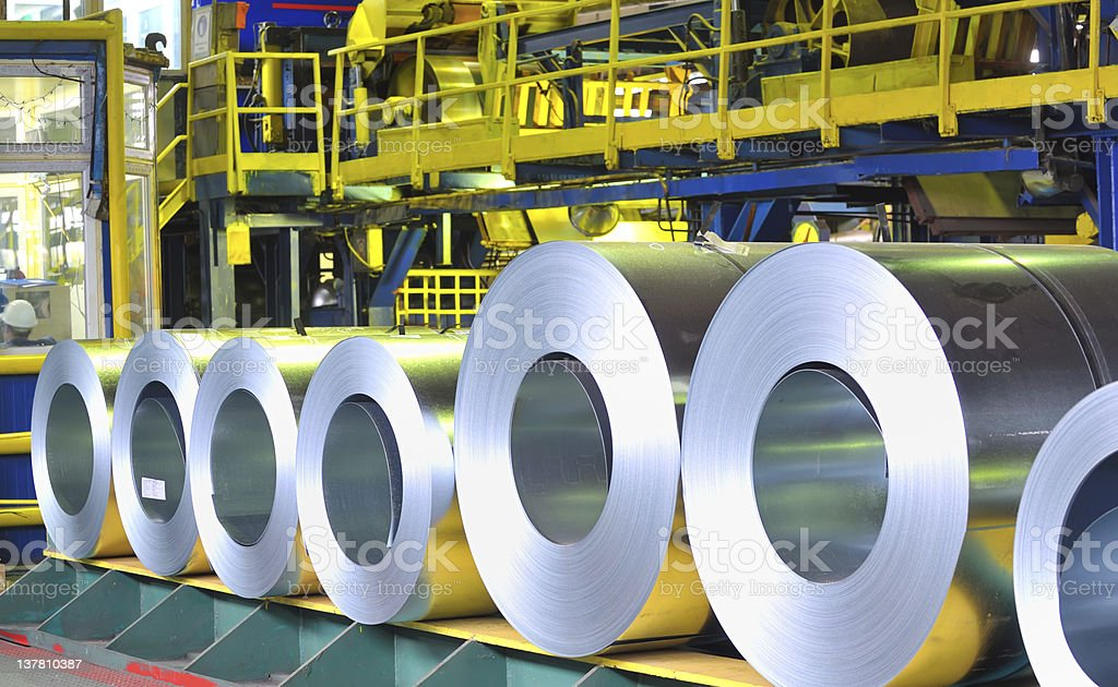 Different sizes of zinc steel sheet rolls lined up stock photo