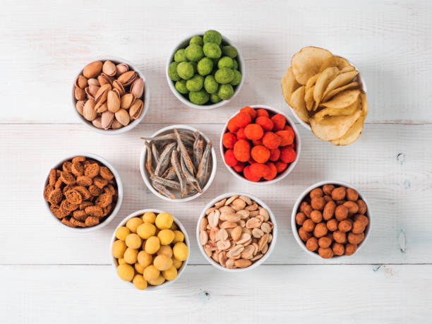 different snacks for beer - peanut food stock photos and pictures