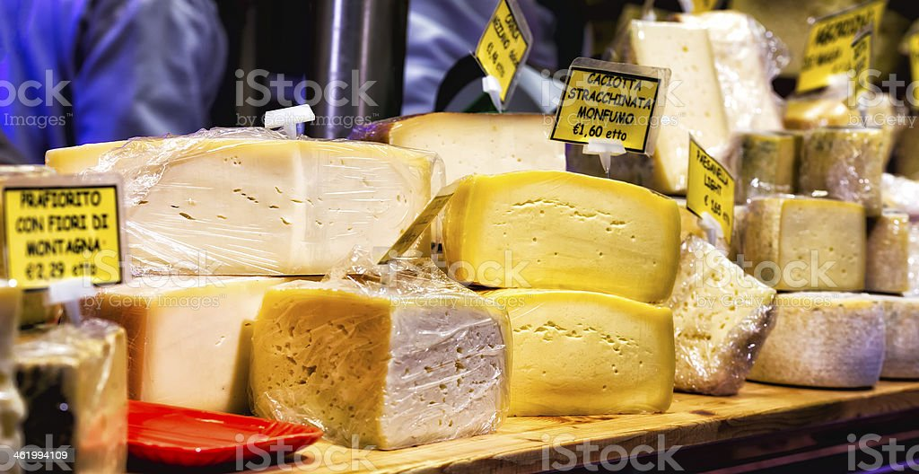 Different Sorts of Cheese on Display at a Local Market stock photo