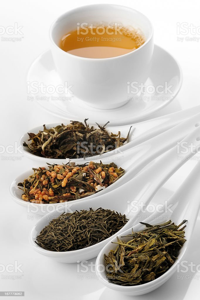 Different sorts of green tea and cup stock photo