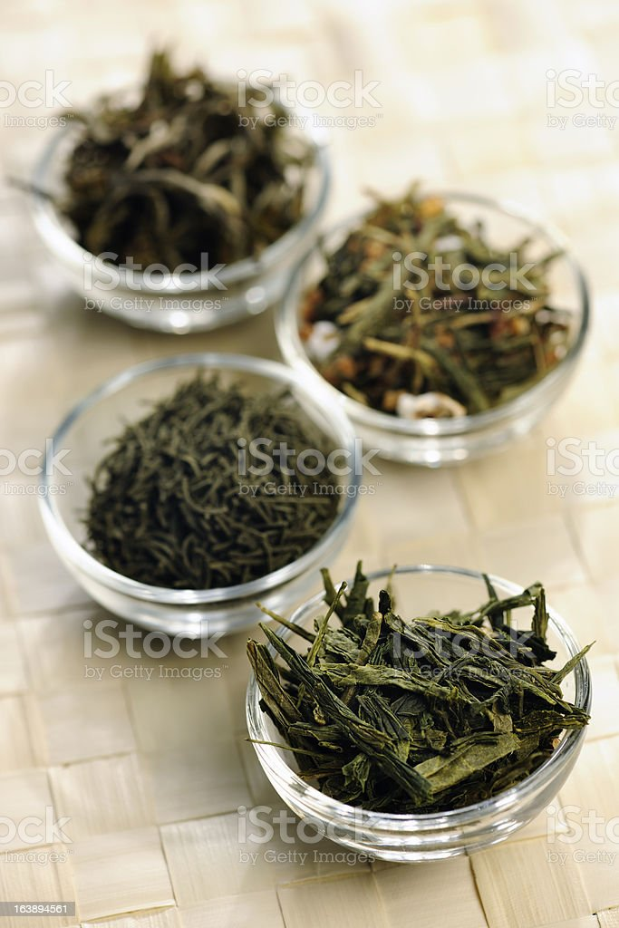 Different sorts of green tea in little bowls stock photo