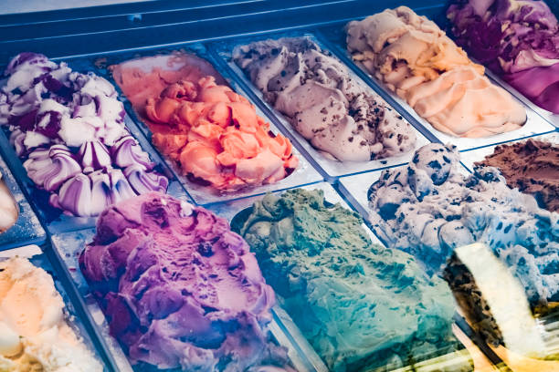 Different sorts of ice cream on the display in refrigerator. Different sorts of ice cream on the display in the refrigerator. handful stock pictures, royalty-free photos & images