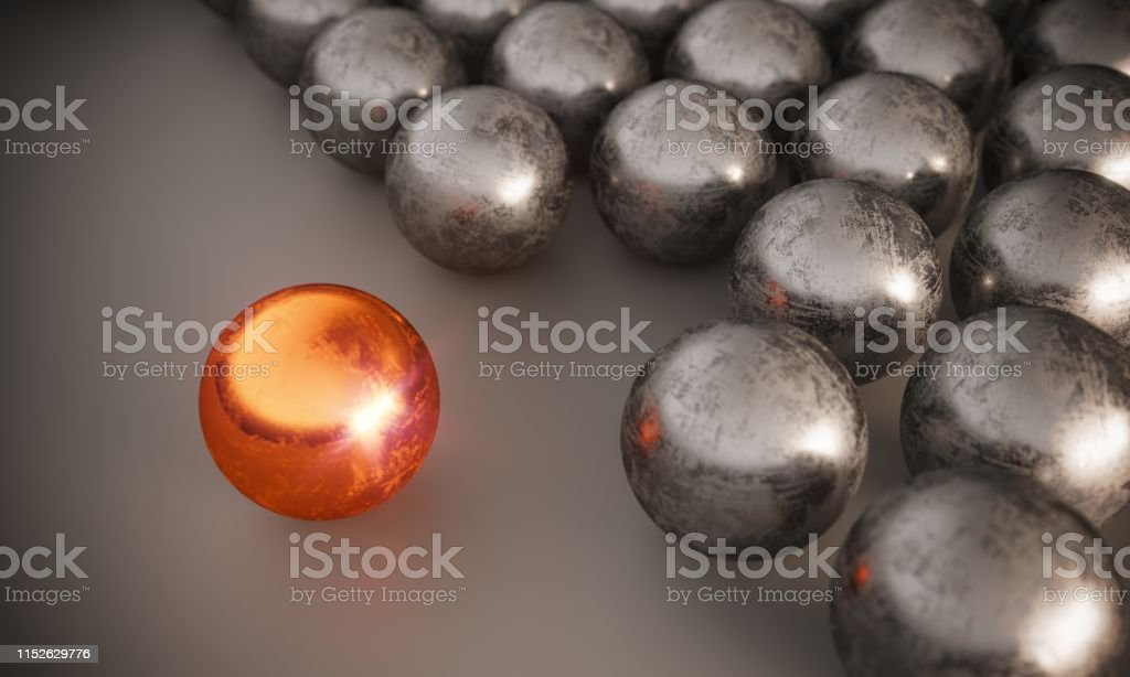 Scratched different colored sphere standing out from steel spheres,...