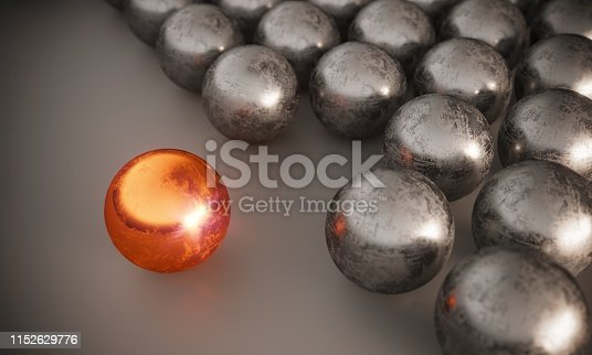 Scratched different colored sphere standing out from steel spheres, symbolizing individuality-leadership concepts. ( 3d render )
