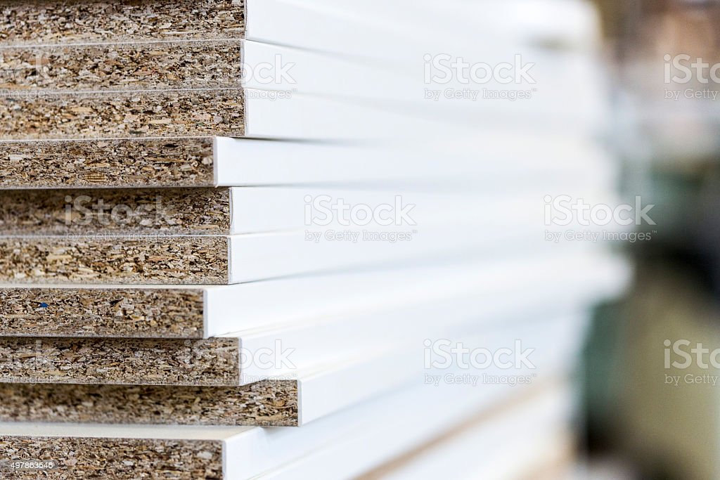 Different stacked chipboards stock photo