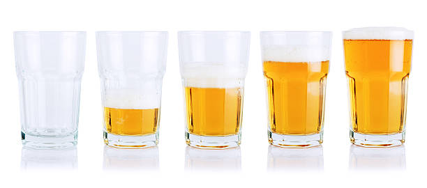 Different stages of beer consumption in five mugs stock photo