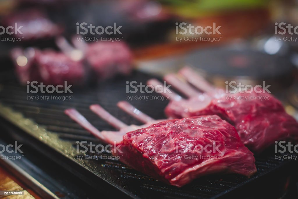 Different Stages Of Cooking The Steak On A Kitchen Barbeque Roasted