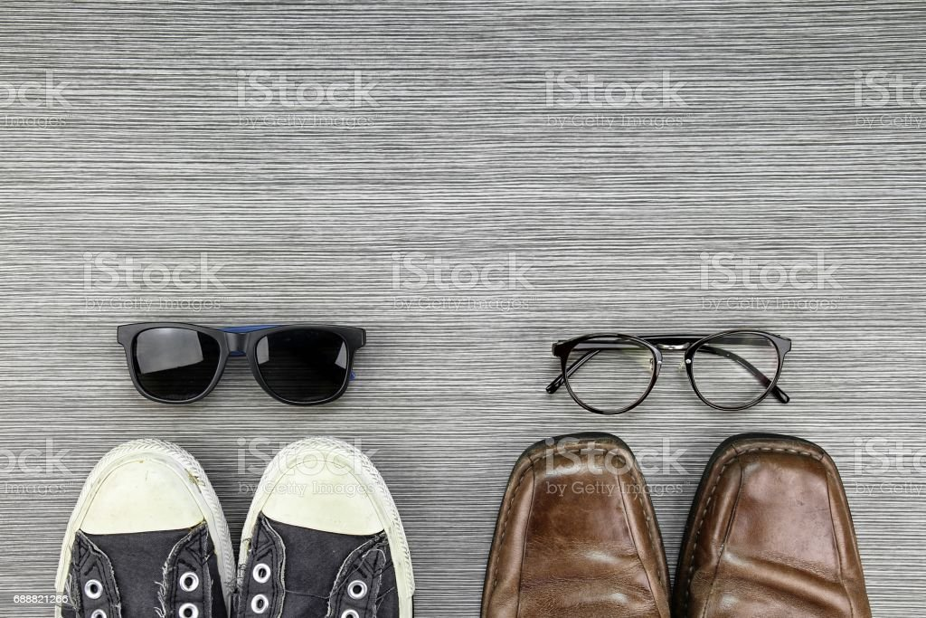 Different Style of men fashion, Compare of formal and casual fashion style, Sneakers, Leather Shoes, Sunglasses, Nerd Glasses. stock photo