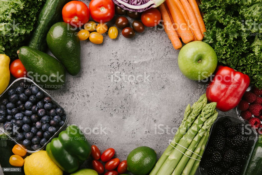 Different tasty vegetables on rough background zbiór zdjęć royalty-free