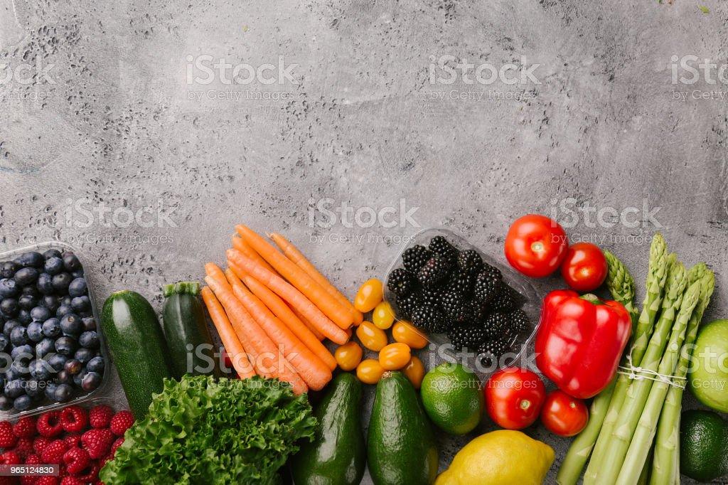 Different tasty vegetables on rough background zbiór zdjęć royalty-free