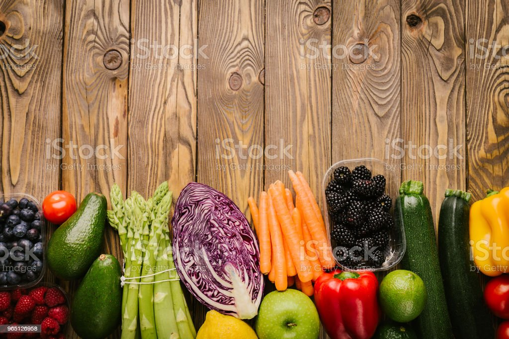 Different tasty vegetables on wooden background royalty-free stock photo