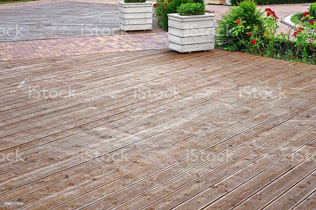 Different Textures Wood And Paving Stone Floors In One Place foto royalty-free