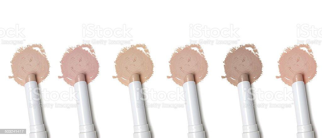 Different tones of concealer stock photo