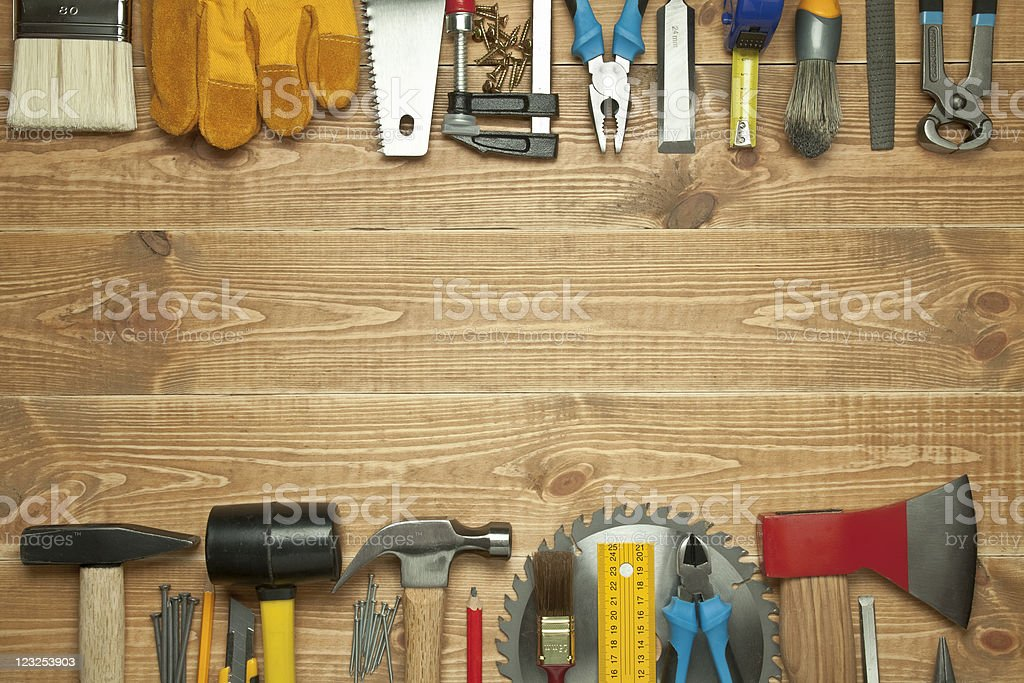Different tools on a wooden background. stock photo