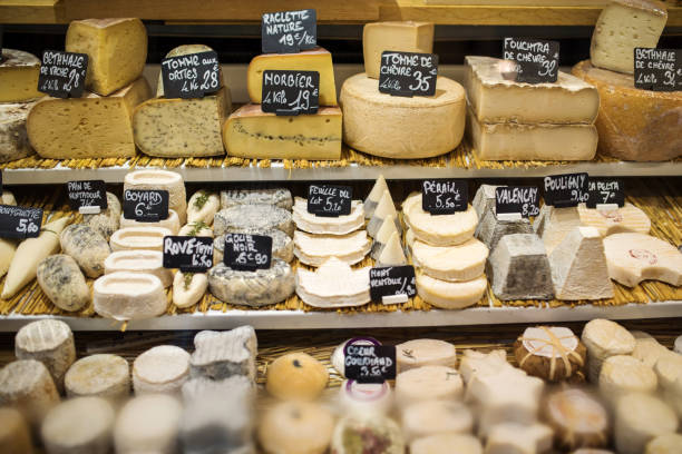 Different type of cheese in store, Paris, France stock photo