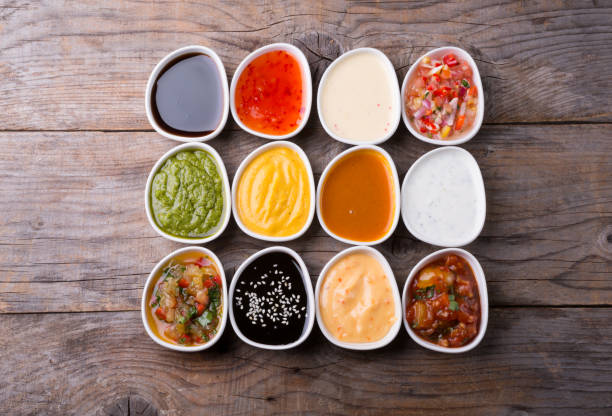 Different type of sauces Different type of sauces served on wooden board salad dressing stock pictures, royalty-free photos & images