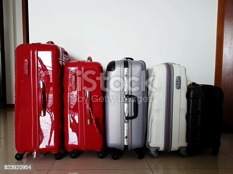 istock Different types, colors and sizes of trolley bag luggages in a row 823920954