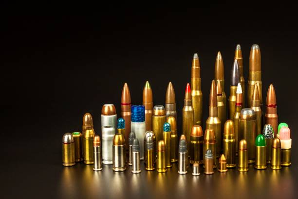 Different types of ammunition on a black background. Sale of weapons and ammunition. The right to hold a gun. Different types of ammunition on a black background. Sale of weapons and ammunition. The right to hold a gun ammunition stock pictures, royalty-free photos & images