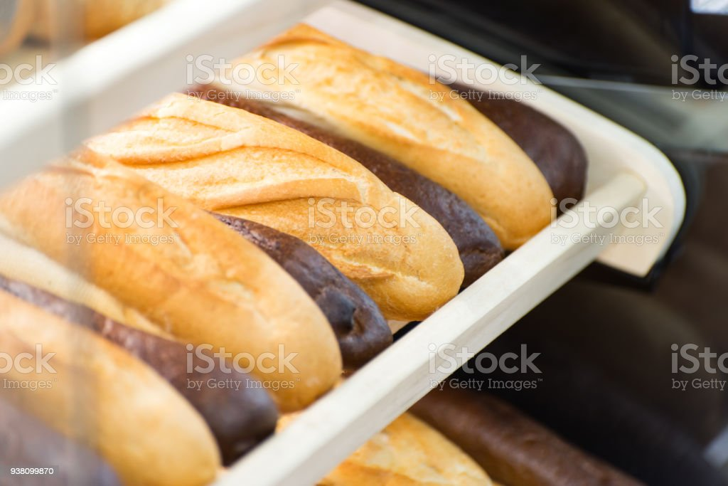 different types of bread on the shelf in the store