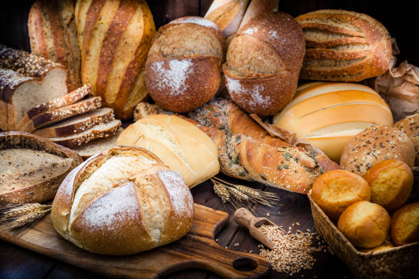 different types of bread still life - panetteria foto e immagini stock
