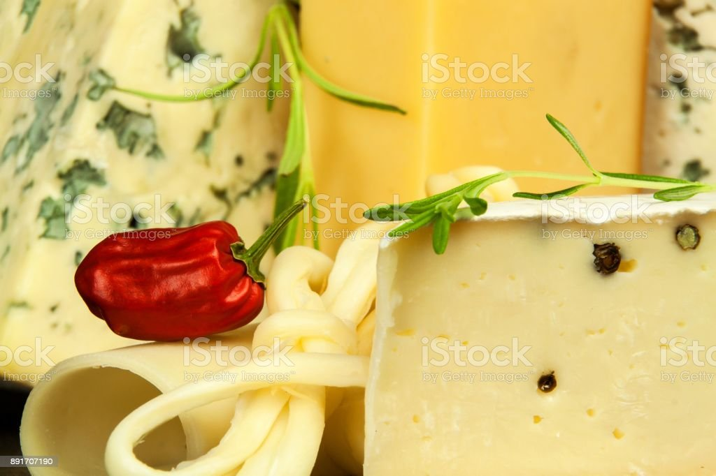Different Types Of Cheeses On The Kitchen Table. Preparation Of Snacks.  Healthy Food.