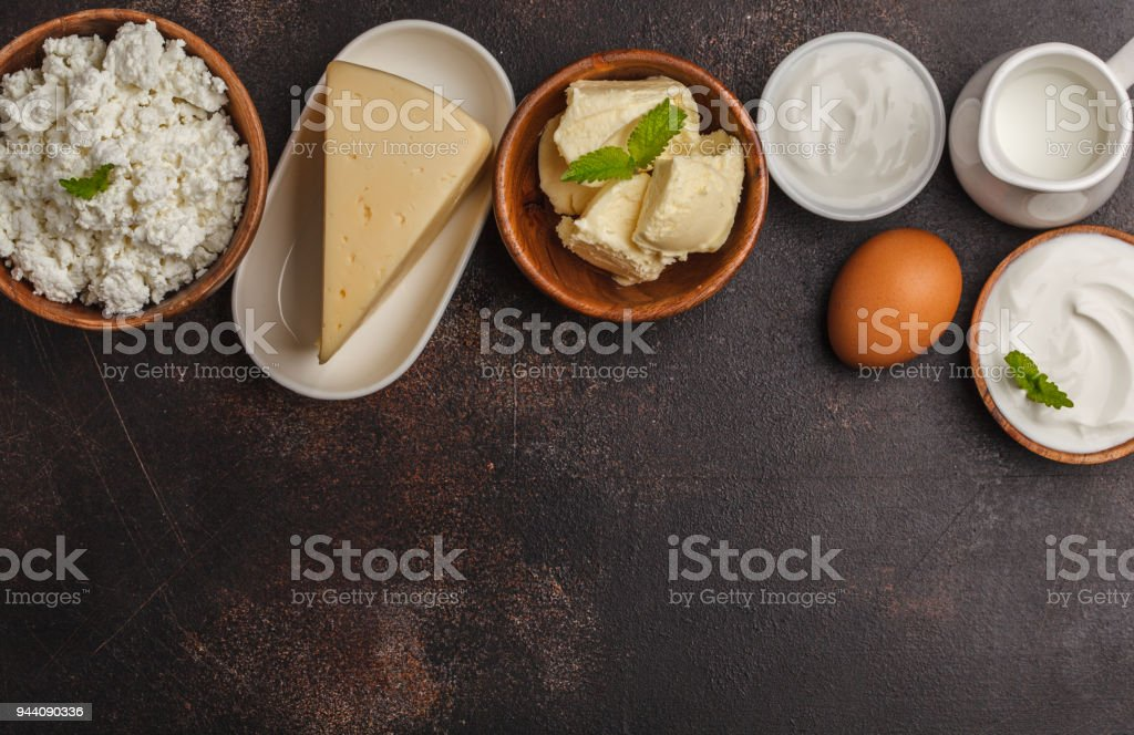 Different types of dairy products on dark background