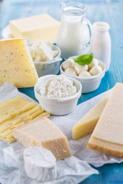 Different types of dairy products on wooden background stock photo