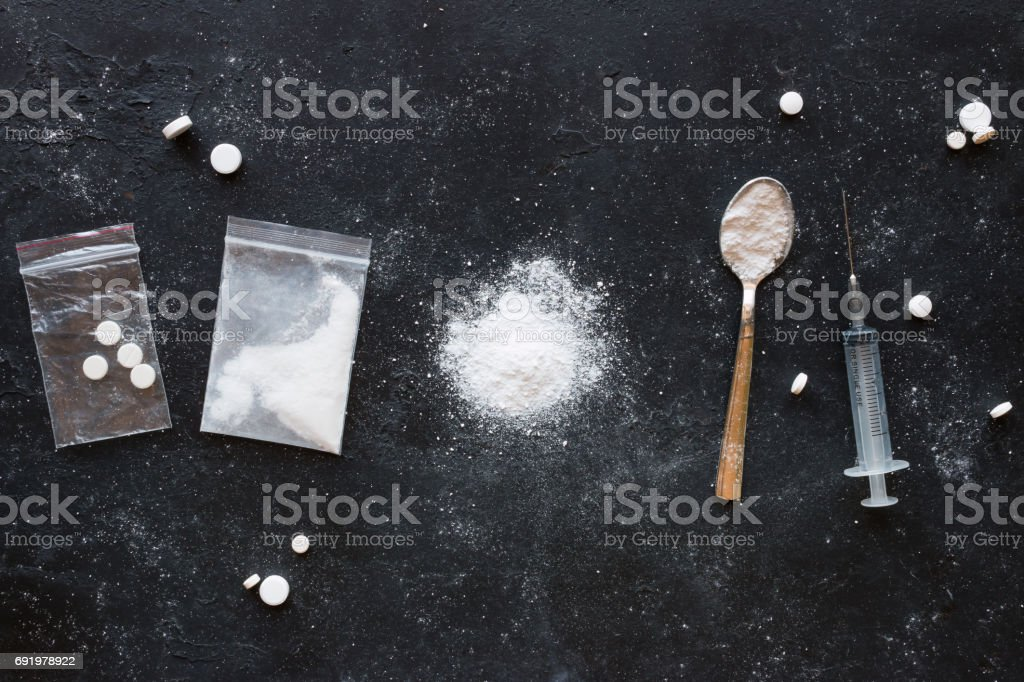Different types of drugs on a black background stock photo