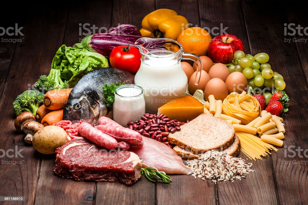 Different types of food on rustic wooden table stock photo